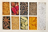 Assortment of powder spices in wooden box on white background — Stock Photo