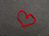 Valentine's day card with red heart symbol black texture background — Photo
