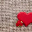 Valentine's day card with red heart symbol on fabric sack texture background — Stock Photo