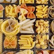 Italian pasta collection in wooden box background — Stock Photo #21190131