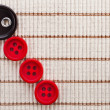 Row color buttons cotton fabric texture — Stock Photo