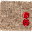 Stock Photo: Buttons on canvas burlap background texture isolated on white background