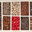 Stock Photo: Assortment of different peppercorns in wooden box