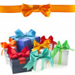 Colorful gift boxes with bows isolated on white background - Foto de Stock