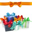 Colorful gift boxes with bows isolated on white background — Stock Photo