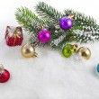 christmas colorful balls and fir branch on white snow background — Stock Photo