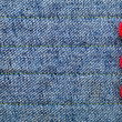 Royalty-Free Stock Photo: Jeans textured background with red buttons