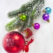 Christmas colorful balls and fir branch on white snow background — Stock Photo #21190759