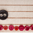 colorful sewing buttons on cotton fabric texture — Stock Photo