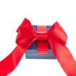 Present box with red ribbon bow isolated on white — Stock Photo #21190921