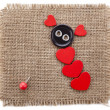 Valentine's day card with wooden red hearts symbol on fabric sack texture background - Stok fotoğraf