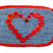 Jeans textured badge with red buttons shape heart isolated on a white background — Stok fotoğraf