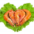 Fresh shrimp on a salad lettuce isolated on white — Photo