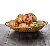 Painted colored easter eggs in basket , isolated on white background — Stock Photo
