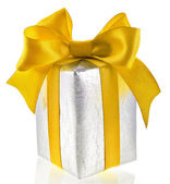 Single silver present box with yellow ribbon bow isolated on white — Stock Photo