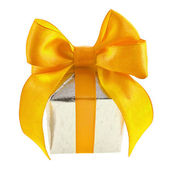 Silver gift box with golden ribbon bow, isolated on white background — Stock Photo