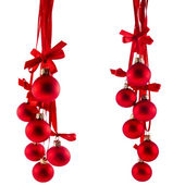 Christmas red balls hanging with ribbon bows isolated on white background — Foto de Stock