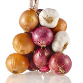 Hanging bunch bundle onion and garlic clove isolated on white background — Stock Photo