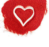 Ground paprika with shapes heart sign on white background — Stock Photo