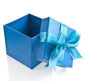 Gift wrapped present box with blue satin bow isolated on white — Stock Photo