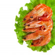 Fresh shrimp on a salad lettuce - Stock Photo