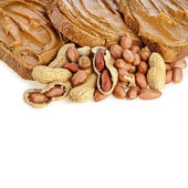 Peanut butter sandwich and peanuts — Stock Photo