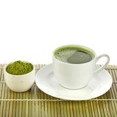 Powdered green tea on bamboo napkin — Stock Photo