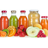 Colorful Bottles juice and puree with fresh berries and fruits — Stock Photo
