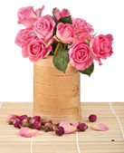 Rose bouquet in wooden vase — Stock Photo