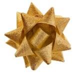 Gift shining golden ribbon bow — Stock Photo