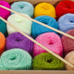 Cardboard box full colorful different thread balls of knitting yarn — Stock Photo