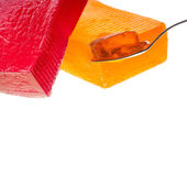 Fruit jelly on tea spoon — Stock Photo