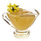 Mustard dish sauce and mustard flower — Stock Photo