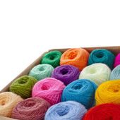 Multi-colored balls of wool knitting yarn in a cardboard box — Stock Photo