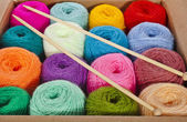Cardboard box full colorful different thread balls of knitting yarn — Stock Photo