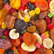 Mixed dried fruits collection top view surface on white background — Stock Photo