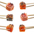 Collection of Japanese sushi rolls with fish and vegetables in wooden chopsticks isolated on white background — Stock Photo #28461893