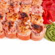 Japanese rolls in a restaurant with fish and vegetables isolated on white background — Stock Photo