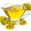 Flower mustard and Oil in gravy boat isolated on white background — Stock Photo
