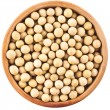Soybeans over wooden spoon isolated on white background — Stock Photo #28462563
