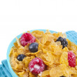 Corn flakes with fresh berries and milk isolated on white background — Stock Photo