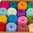 Fabric accessories for retail haberdashery, multi-colored balls of wool — Stock Photo
