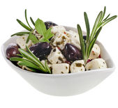 Olives with feta cheese in a bowl of porcelain isolated on white background — Stock Photo