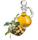 Olives branch on bowl and olive oil decanter isolated on white background — Stock Photo