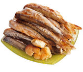 Fried smelts Baltic fish on a dish isolated on white background — Stock Photo