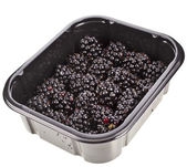 Ripe BlackBerries in plastic container box, isolated over a white background — Stock Photo
