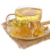 Tea cup with linden honey isolated on white background — Stock Photo