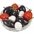 Black Olives with tomato, mozzarella in bowl close up isolated on white background — Stock Photo