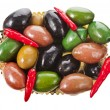 Large colorful olives surface with hot peppers background — Stock Photo