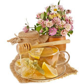 Sweet flower honey in barrel and wooden drizzler in in cloth burlap napkin isolated on white background — Stock Photo